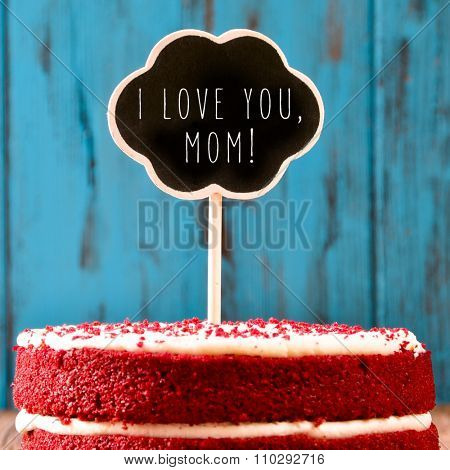 closeup of a red velvet cake topped with a chalkboard in the shape of a thought bubble with the text I lovey you mom, against a blue rustic wooden background