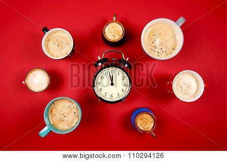 Many cups of coffee with alarm clock