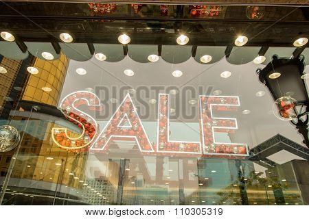 word sale spell with bubbles on shopfront window