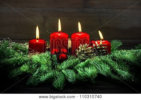 Advent Decoration. Four Red Burning Candles. Vintage Style