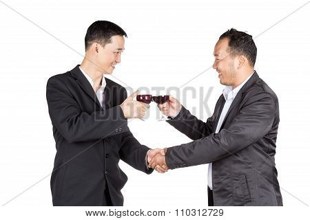 Two Business Man Holding A Glass Of Wine And Handshaking