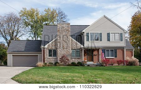 House with Large Stone Fireplace Chimney