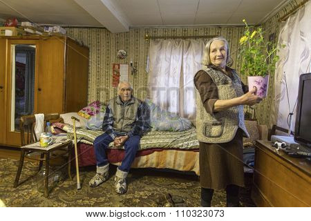 VINNITSY, RUSSIA - NOV 30, 2015: Elderly couple Veps - small Finno-Ugric peoples living on the territory of Leningrad region in Russia. According to the 2002 census, there were 8,240 Veps in Russia.