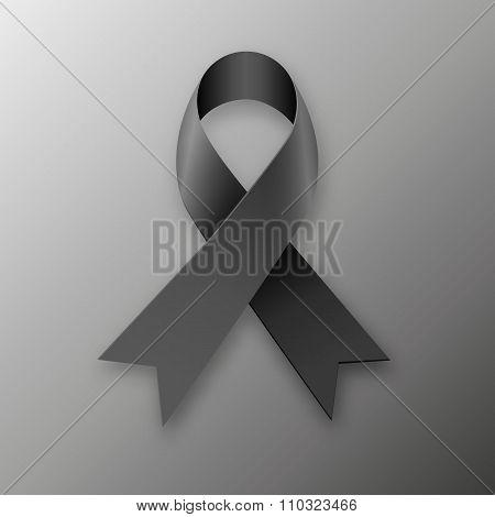Black awareness ribbon on dark background