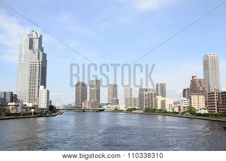 Sumida river and high-rise buildings in Tokyo Japan
