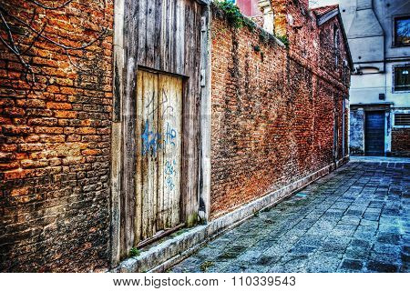 Brick Wall And Wooden Door In Venice