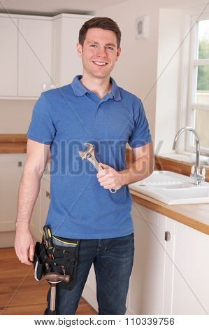 Plumber Fixing Kitchen Tap With Adjustable Wrench