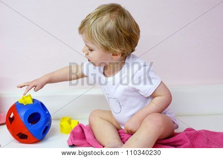Little toddler boy playing with  puzzle toys