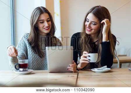 Beautiful Young Women Using Digital Tablet In Coffee Shop.