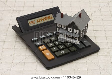 Home Mortgage Pre-approval, A Gray House And Calculator On Stone Background