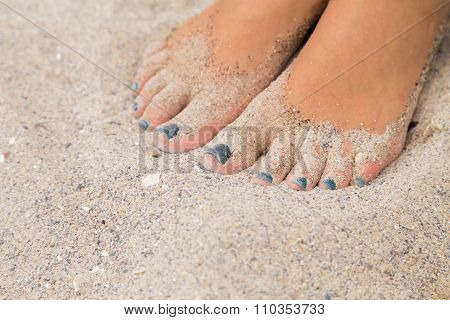 Beautiful feet in the sand. Sea, sand, rest, macro.