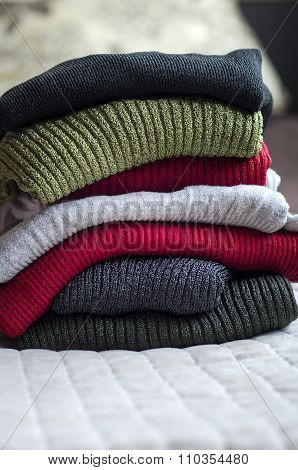 Pile Of Warm Sweaters
