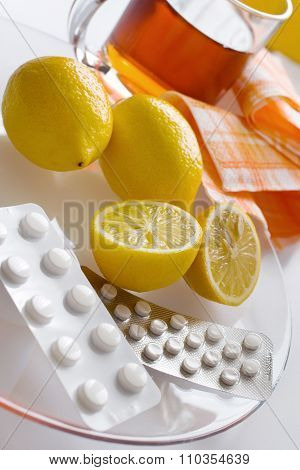 Black Tea With Fresh Lemons And Flu Pills In Blister With Thermometer - Home Grippe Remedy