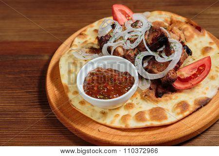 Shish kebab on bread. Tasty and healthy food, European cuisine.