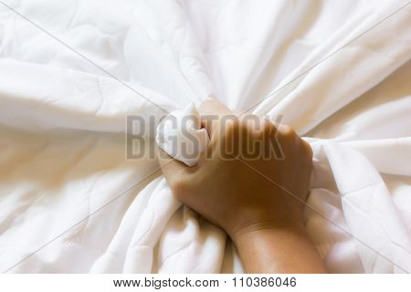 Hand Strongly Grasp White Bed Sheet