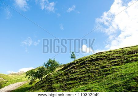 Green Hills Near River Dove In Peak District National Park