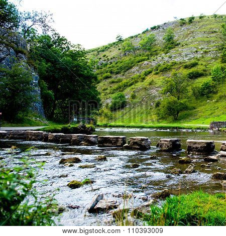 Green Hills, Stepping Stones Near River Dove In Peak District National Park