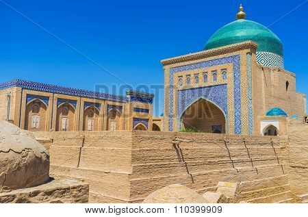 The scenic dome and portal of Pahlavon Mahmud Mausoleum decorated by islamic patterns made of glazed tiles Khiva Uzbekistan. poster