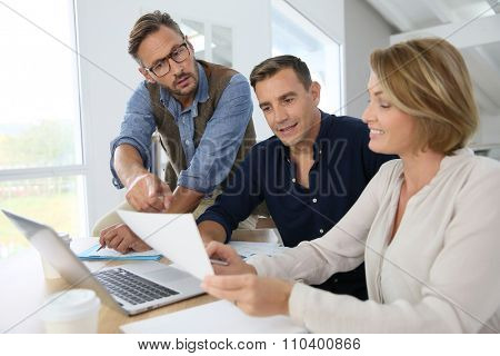 Financial department people working on budget plan