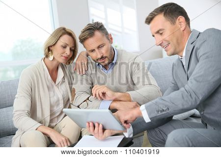 Financial adviser showing terms of contract on tablet