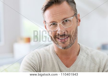 Portrait of handsome 40-year-old man with eyeglasses poster