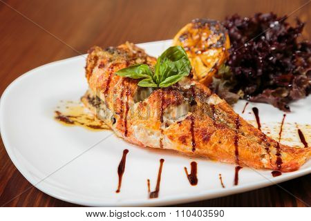Mouthwatering fried fish cooked with vegetables