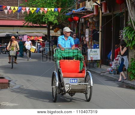 A Cyclo On The Street In Hoi An