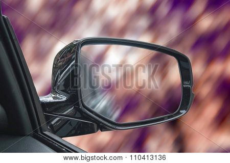 Vintage tone, abstract car's wing mirror with blurred bokeh speed motion background and o