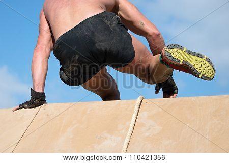 Man jumping over wal