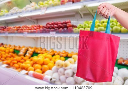 Closeup Hand Holding Reusable Bag In Supermarket