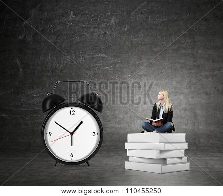 Woman Sitting On Pile Of Book, Big Alarm Clock  Right