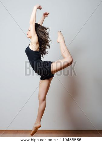 Young Ballet Dancer Jumping High In The Air
