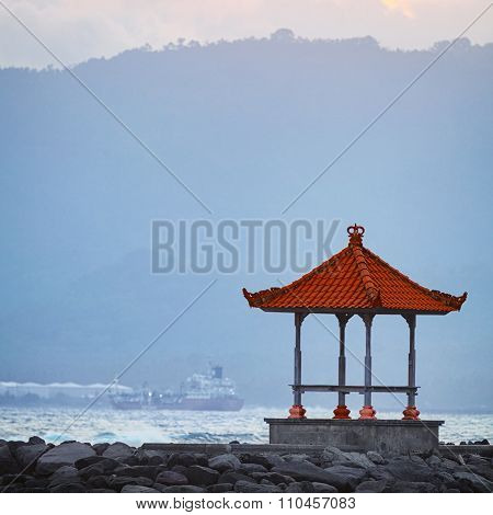 Buddhist Pagoda On A Rocky Jetty