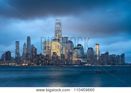 Lower Manhattan Illuminated Skyscrapers And Storm Clouds, New York City