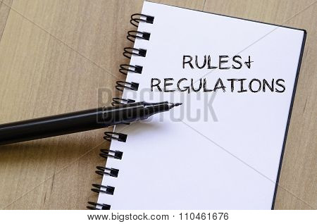 Rules And Regulations Write On Notebook