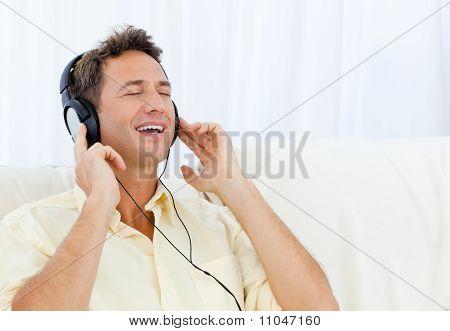 Quiet Man Listening Music On The Sofa