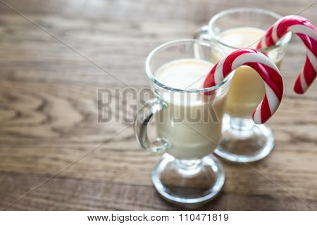 Two Glasses Of Eggnog With Candy Cane