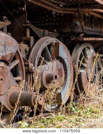 Close Up Wheels On Abandoned Stream Powered Locomotive.