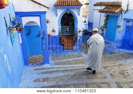 CHEFCHAOUEN, MOROCCO, OCTOBER 24 2015: Street life in the Blue city of Chefchaouen, one of the touristi destinations of Morocco, Africa