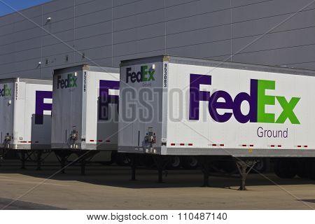Indianapolis - Circa December 2015: Federal Express Trucks in Loading Docks.