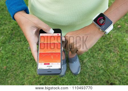 Bangkok, Thailand - Dec 5, 2015 : Women Using Iphone 6S And Apple Watch Check Health Application