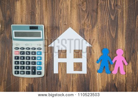 housing and mortgage for young families. couple dreaming paper house with calculator poster