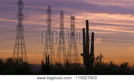 Desert sunset power electricity pylons on beautiful Arizona evening