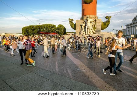 July 5 2015.Saint-Petersburg.The townspeople are dancing near the Rostral columns in St. Petersburg Russia