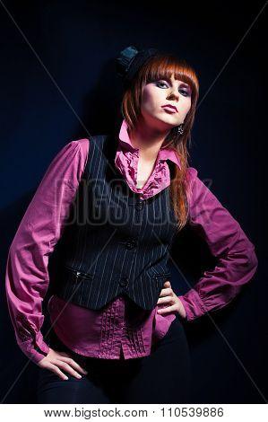 studio portrait of pretty fashionable girl on dark