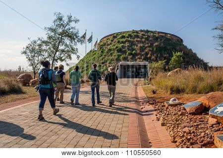 Visitors at the entrance to Maropeng, Tumulus Building. A tourist attraction in South Africa: Maropeng Tumulus Building, Kromdraai Rd, Johannesburg, South Africa. June 1, 2010.