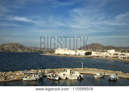 Fishing boats at the pier with tilt shift effect in Paros, Greece
