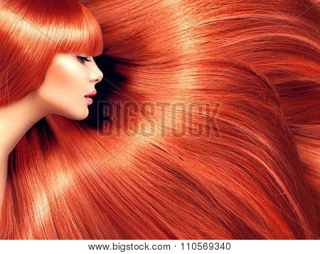 Beautiful Hair. Beauty woman with luxurious long red hair as background. Beauty model girl with healthy hair. Lady with shily smooth straight hair. Hairstyle, hair care,cair cosmetics concept