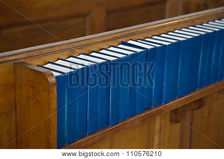 Row of hymnals in a Danish church
