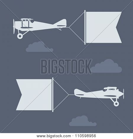 Flying biplanes with blank greetings banner (flag)